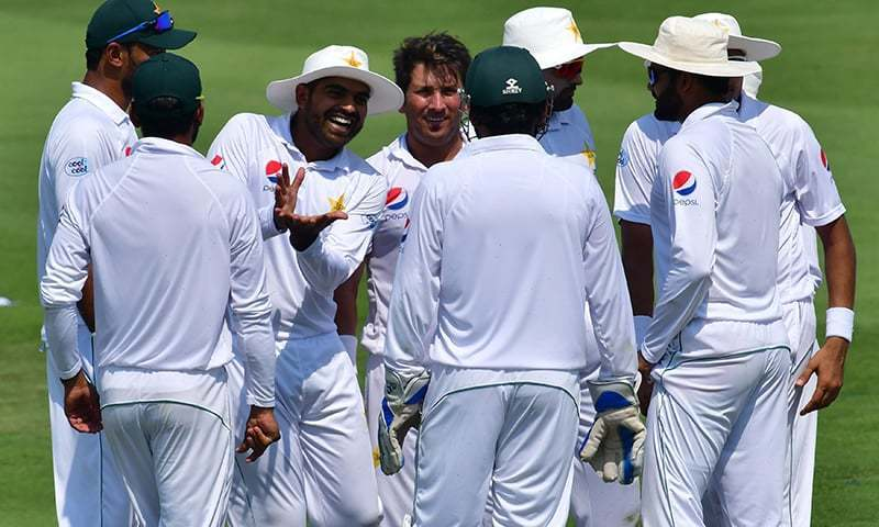 Pakistan cricketers celebrates after Australian cricketer Mitchell Marsh was dismissed during day two of the second Test cricket match in the series between Australia and Pakistan at the Abu Dhabi Cricket Stadium in Abu Dhabi. — AFP