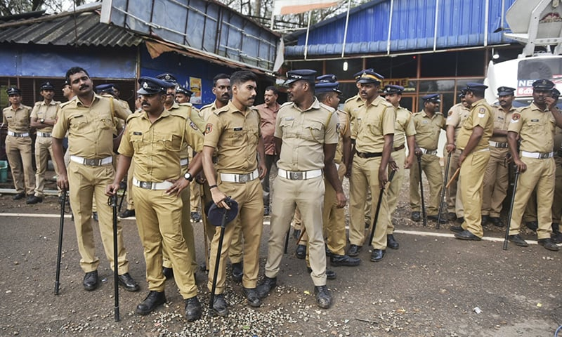 Indian policemen are deployed to guard against protestors who are opposed to allowing women of menstruating age from entering the Sabarimala temple at Nilackal, a base camp on way to the mountain shrine in Kerala, India on October 17, 2018. — AP