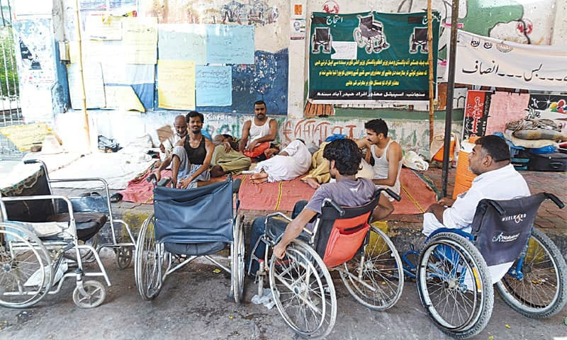 A group of people on wheelchairs are seen in this file photo. — White Star/File