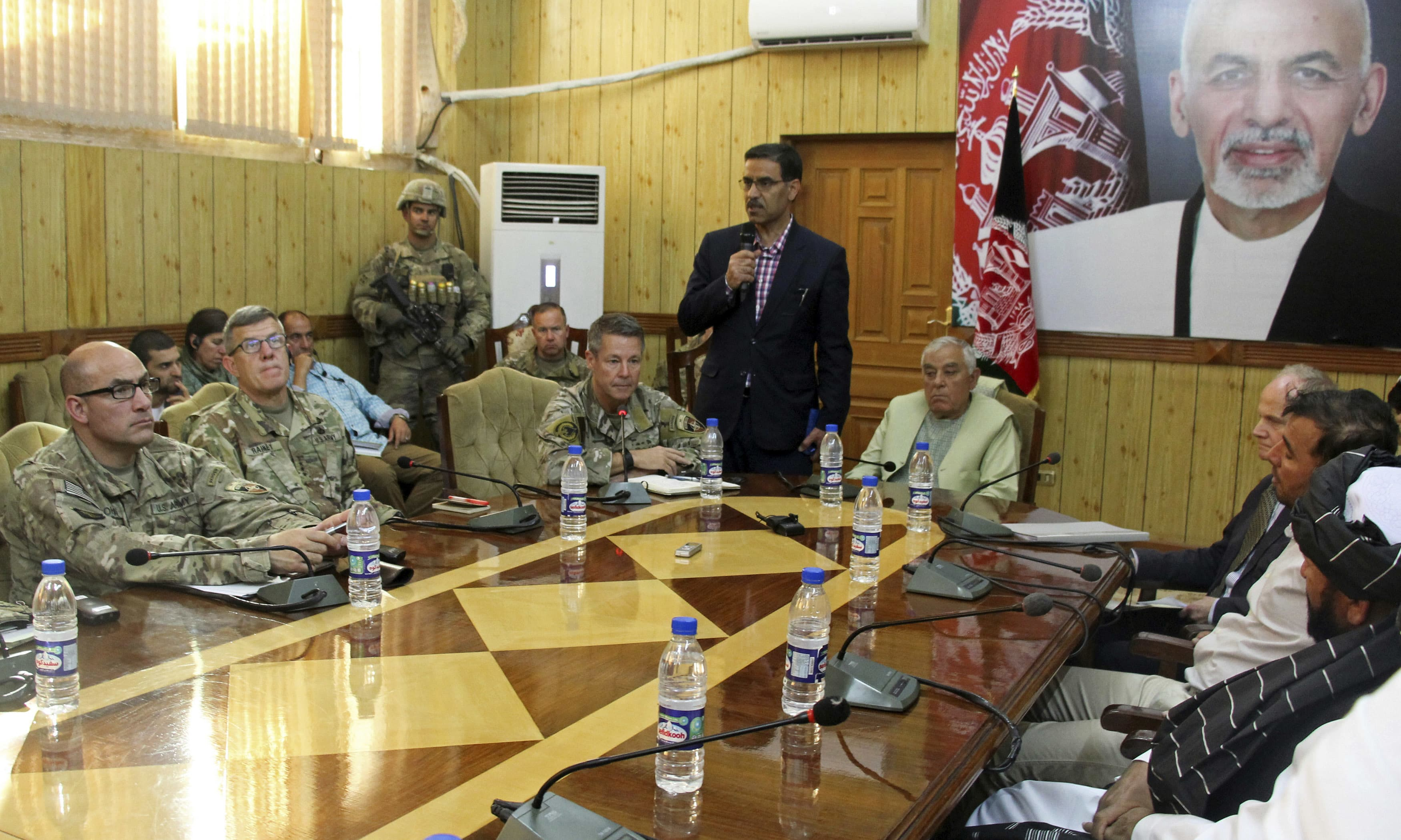 Head of Nato troops in Afghanistan Gen Scott Miller, Kandahar Governor Zalmay Wesa and their delegations attend a security conference in Kandahar. —AP
