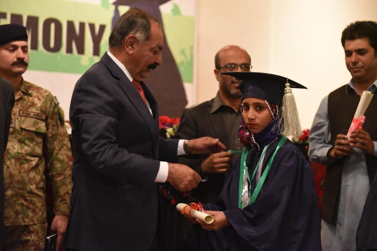 An ALP student receives her certificate from Balochistan Governor retired Justice Amanullah Khan Yasinzai. — Photo by author