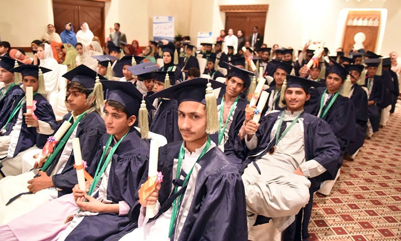 ALP students hold their primary education certificates at a ceremony in Quetta on Friday. — Photo by author