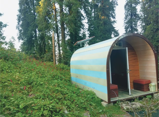 Two-person pod with solar panel at the campsite