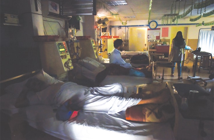 PATIENTS at the Sindh Government Hospital Liaquatabad's dialysis ward suffer during the power breakdown on Saturday.—Fahim Siddiqi / White Star