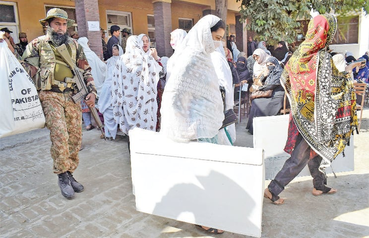 Security officials and election staff shift polling material from a government school on Kohat Road, Peshawar, for by-elections on PK-71 being held on Sunday (today). — White Star