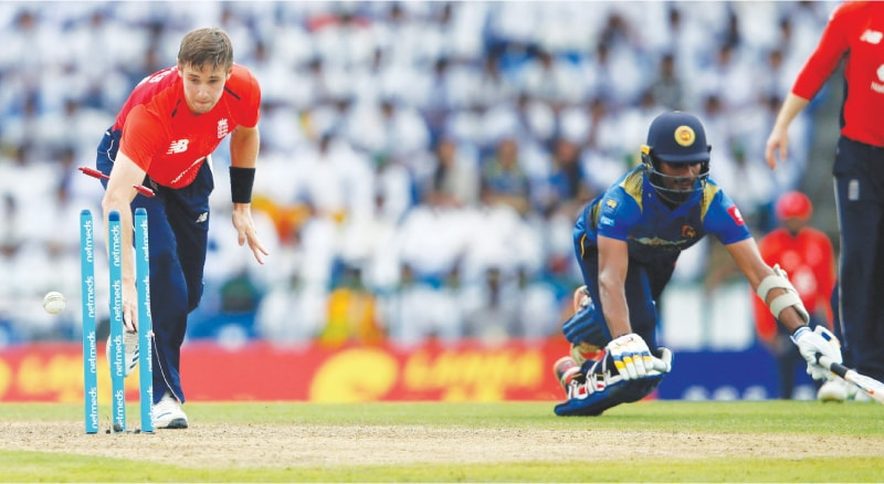 PALLEKELE: Sri Lanka's top-scorer Dasun Shanaka is run out by England all-rounder Chris Woakes for 66 during the fourth One-day International at the Pallekele International Cricket Stadium on Saturday.—Reuters