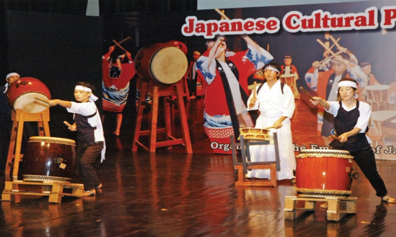 Artists perform the Waidako, the traditional beating of the drums, at the PNCA on Sunday. — Photo by Ishaque Chaudhry