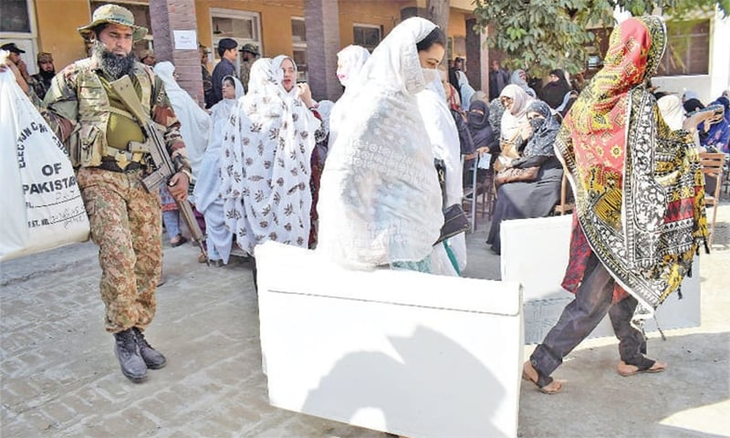 Security officials and election staff shift polling material from a government school on Kohat Road, Peshawar, for by-elections on PK-71 being held on Sunday. — White Star