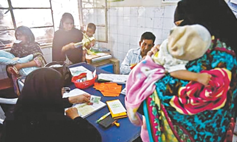 MOTHERS wait in line at the KMC maternity hospital in Gizri to get their newborns vaccinated.—Fahim Siddiqi / White Star