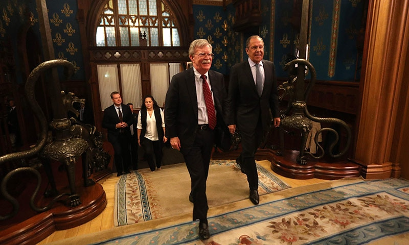 This handout picture released by the Russian Foreign Ministry shows John Bolton (L), National Security Adviser to the US President and Russia's Foreign Minister Sergei Lavrov (R) entering a hall during their meeting in Moscow on October 22. — AFP