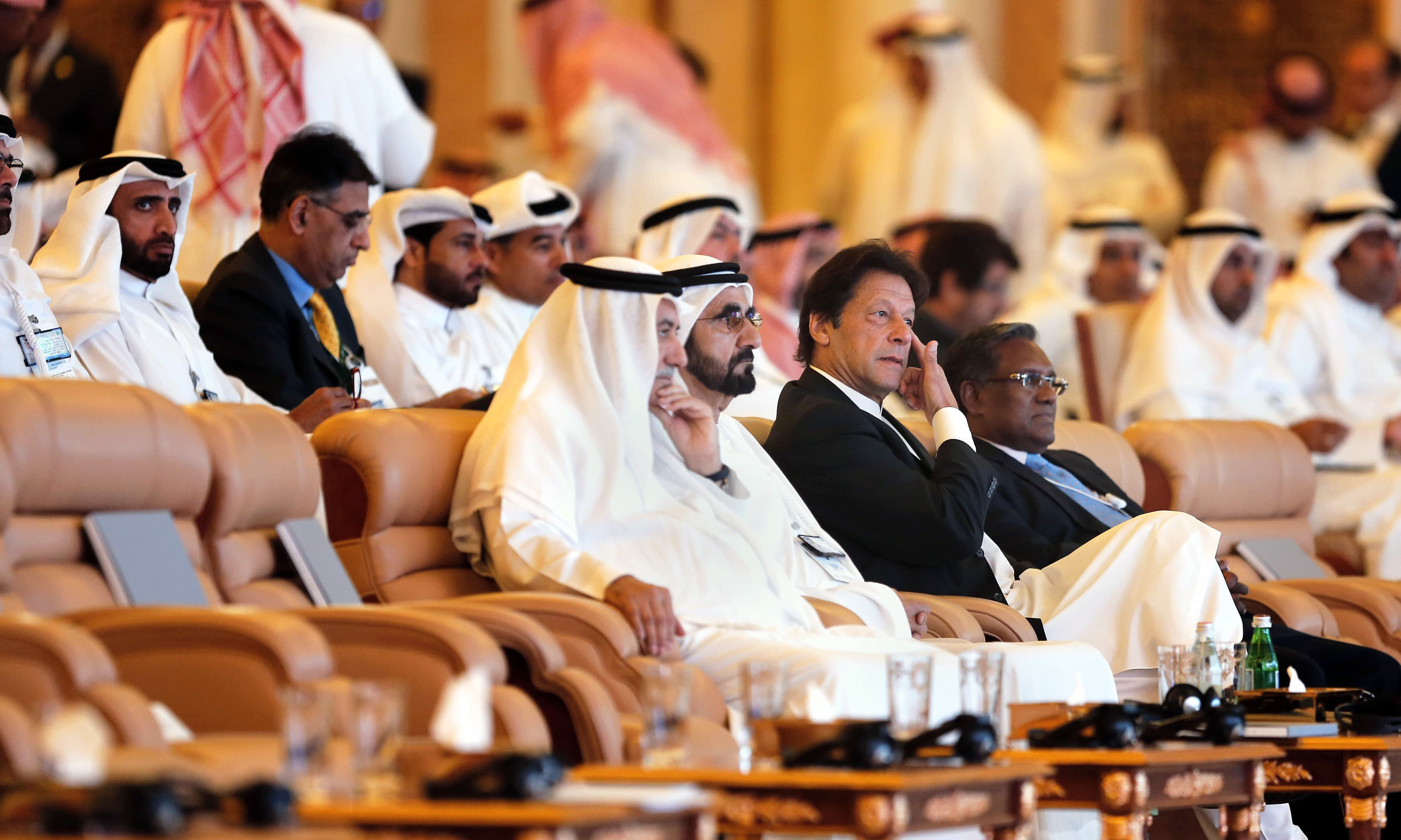 PM Khan sits next to UAE PM Sheikh Mohammad bin Rashed as they attend the opening ceremony. —AP