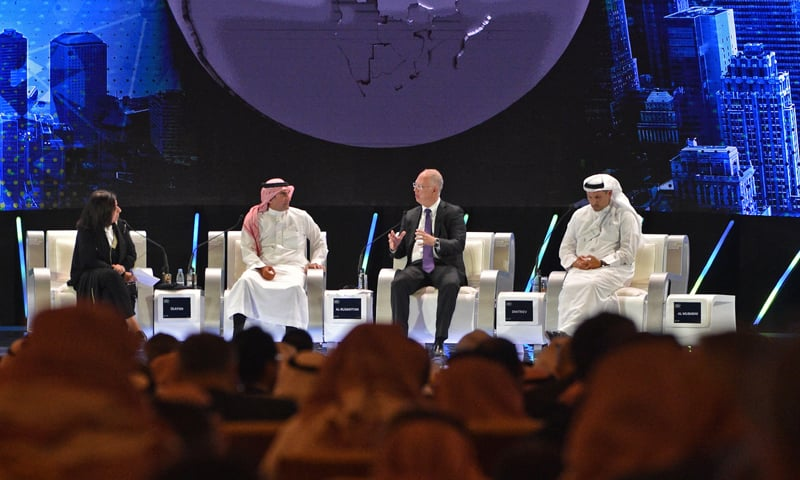 RIYADH: (L to R) Lubna Olayan, CEO and Deputy Chairperson Olayan Financing, Yesir al-Rumayyan, Saudi managing director of Public investment Fund, Kirill Dmitriev, CEO of Rusian Direct Investment Fund and Khaldoon Khalifa al-Mubarak, managing director and CEO of Mubadala Development Company, speaking at  the opening ceremony of the Future Investment Initiative FII conference on Tuesday.—AFP