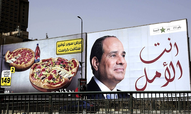 "In this March 19, 2018 file photo, an election billboard for Egyptian President Abdel-Fattah el-Sissi, with Arabic that reads, ""you are the hope,"" hangs in Cairo, Egypt. — AP"