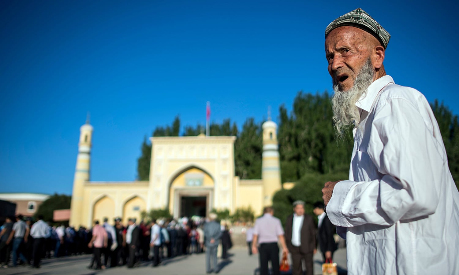This file picture taken on June 26, 2017 shows a Muslim man arriving in front of the Id Kah Mosque for the morning prayer on Eidul Fitr in the old town of Kashgar. — AFP