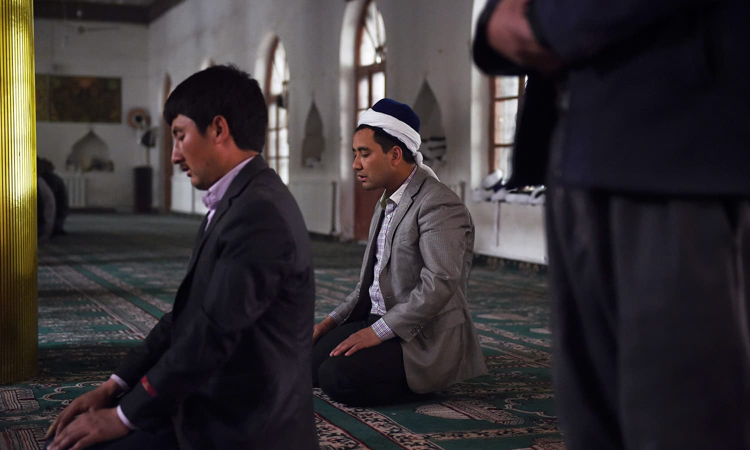 Uighur men pray in a mosque in Hotan, in China's western Xinjiang region in this April 16, 2015 photo. — AFP