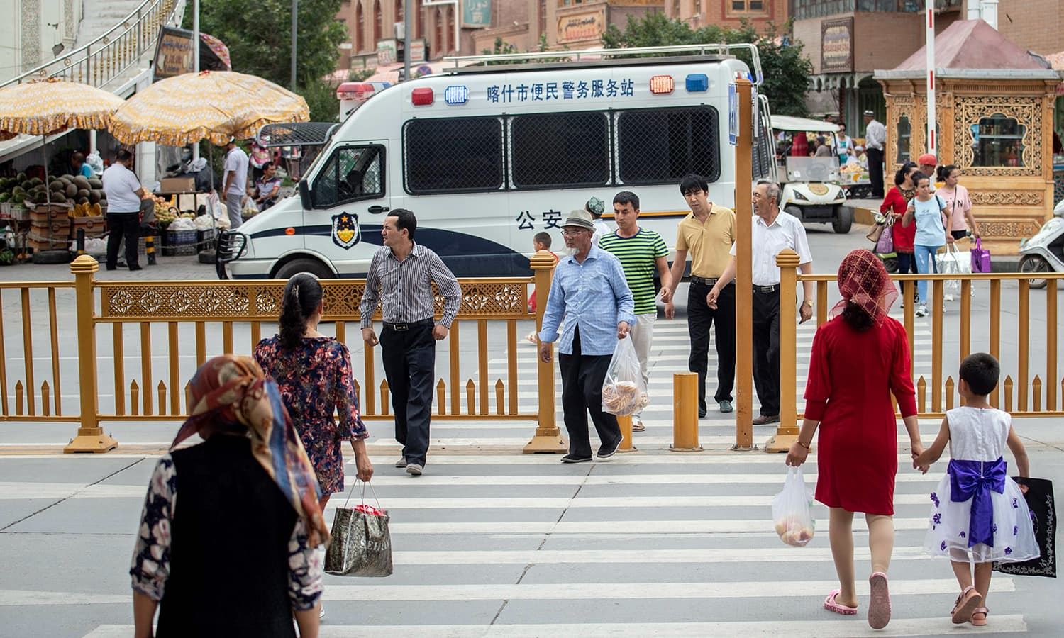 A police vehicle patrols the streets near the Id Kah Mosque in Kashgar. — AFP