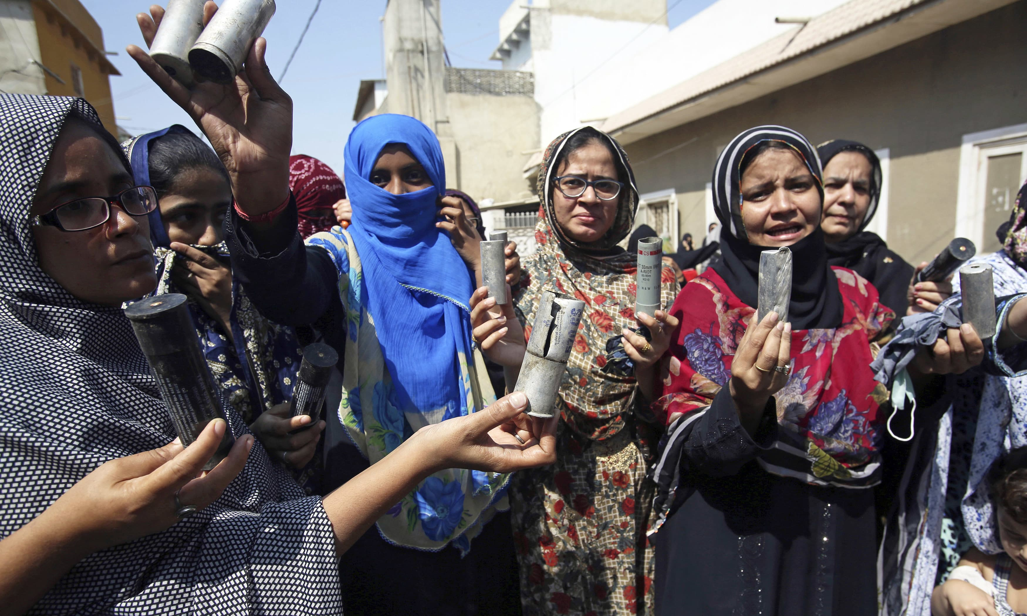 Residents show tear gas shells fired by police to disperse protesters. —AP