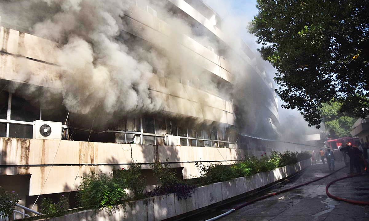 Smoke emitting after fire erupts in PID building. — APP