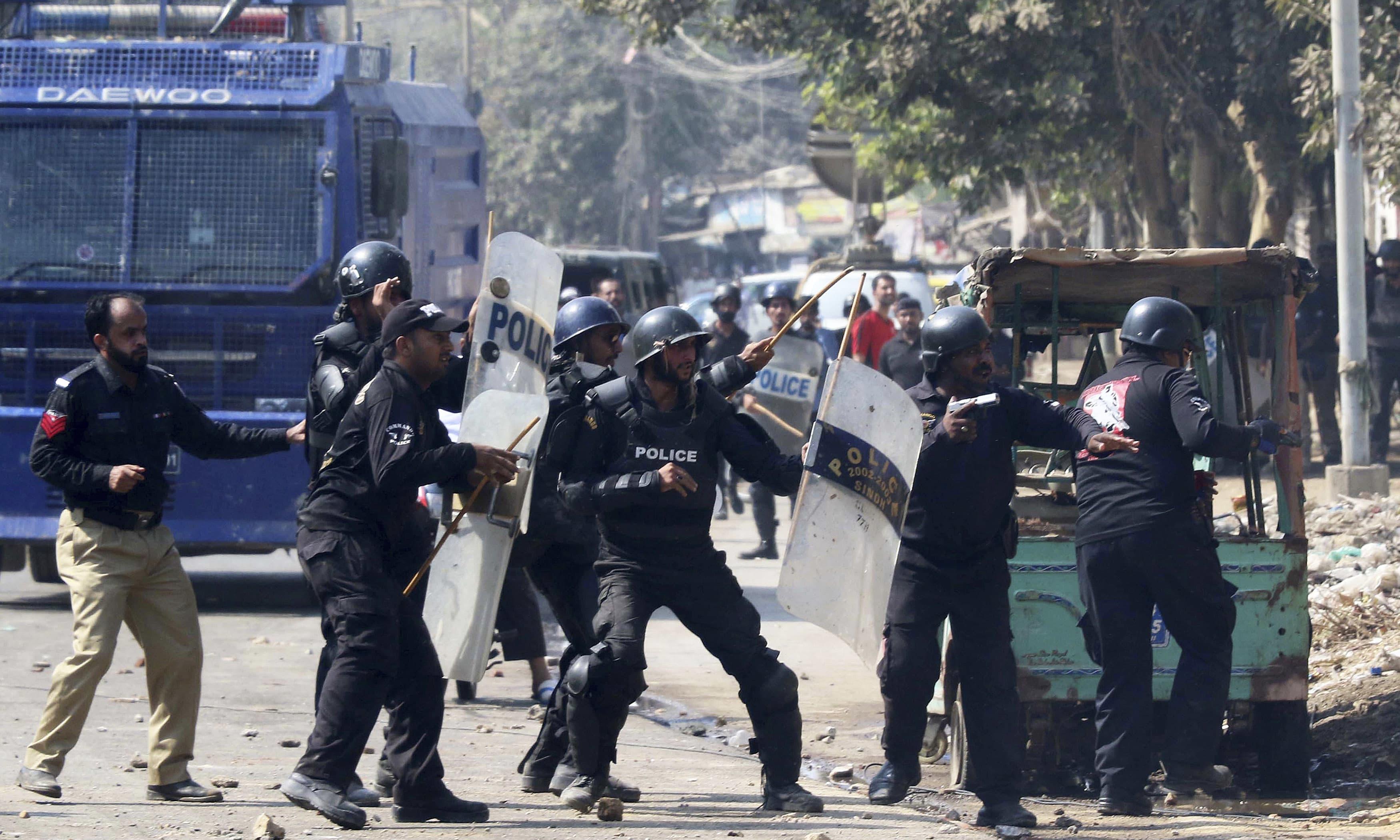 Police disperse protesters in Karachi. —AP