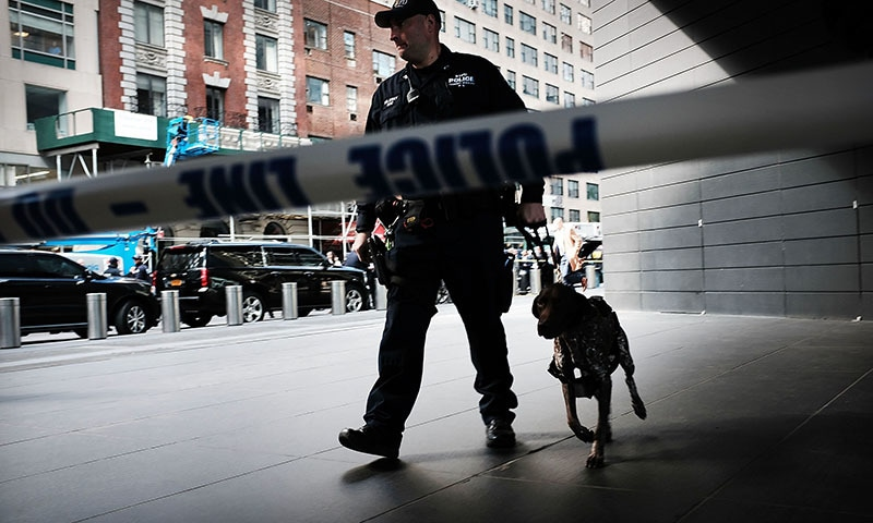Police stand guard outside of the Time Warner Center after an explosive device was found there on October 24, 2018 in New York City. — AFP
