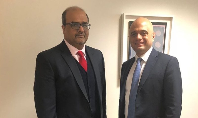 SAPM Mirza Shahzad Akbar with UK Home Secretary Sajid Javid in London. — Photo by author
