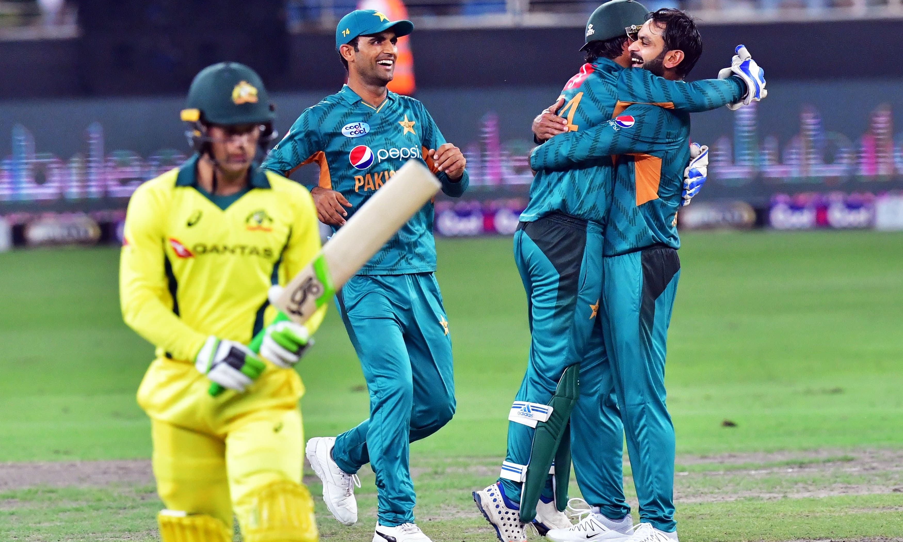 Muhammad Hafez celebrates after dismissing Australian cricketer Alex Carey.—AFP