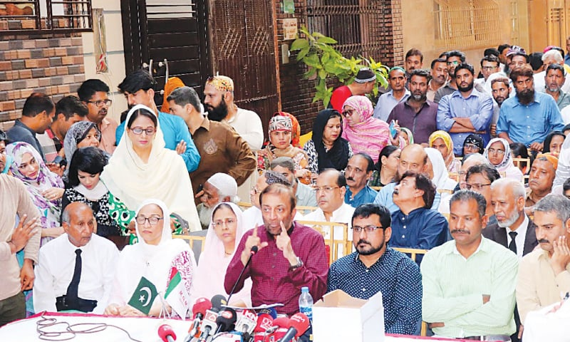 Farooq Sattar speaks outside his PIB Colony residence on Friday. —PPI