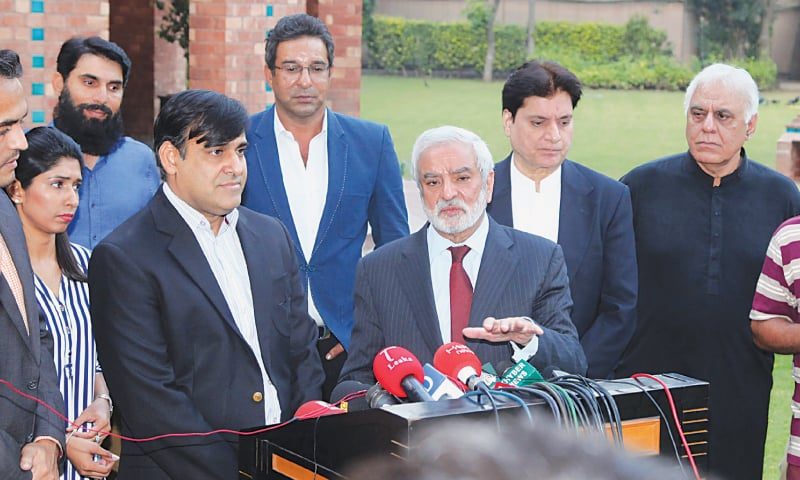 PCB chairman Ehsan Mani alongside chief operating officer Subhan Ahmed speaks to reporters as Misbah-ul-Haq, Wasim Akram, Mohsin Khan, Haroon Rasheed and Urooj Mumtaz look on. — M. Arif/White Star