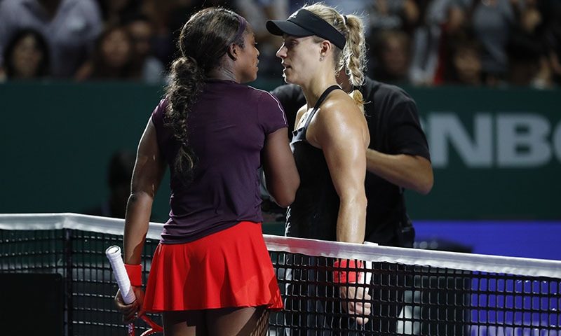 Sloane Stephens of the United States, left, greets by Angelique Kerber of Germany during their women's singles match at the WTA tennis finals in Singapore on Oct 26. — AP