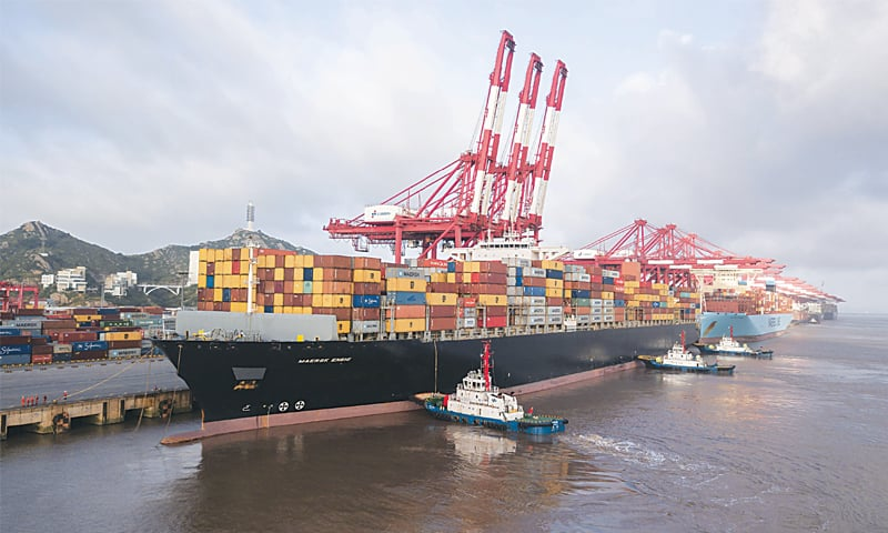 A container ship is seen at the Yangshan Deep Water Port in Shanghai in this file photo.—Bloomberg