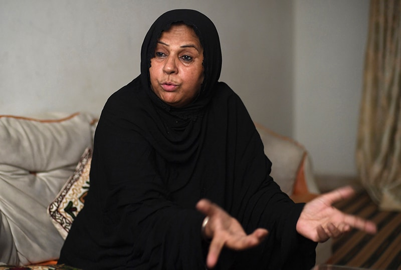 Public health department official Sarwat Zehra speaks during an interview with AFP at her home in Zaman Town in the eastern district of Karachi. ─ AFP