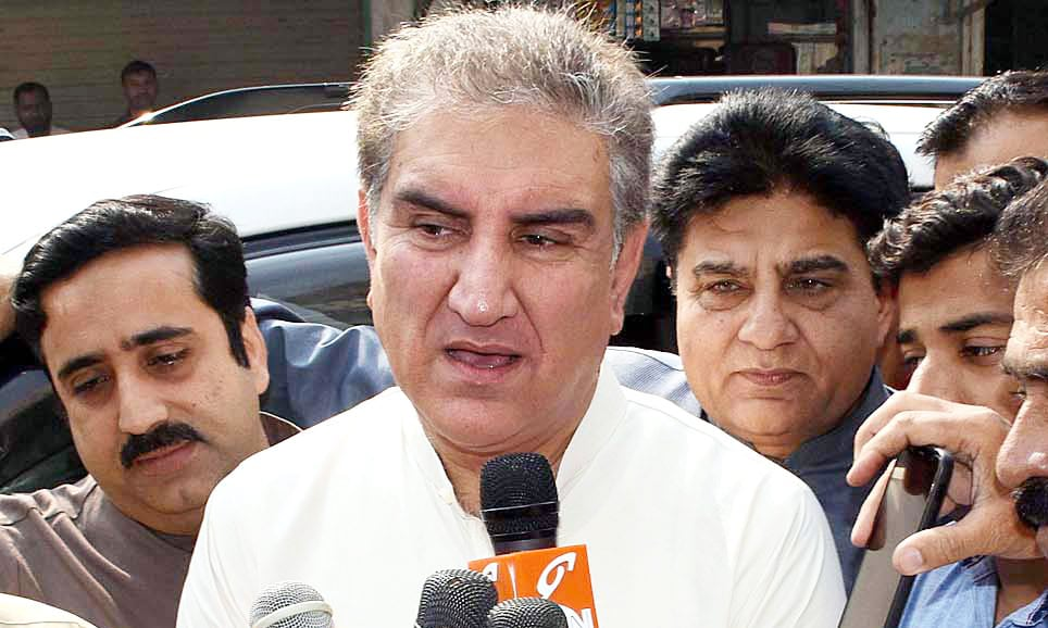 Foreign Minister Shah Mehmood Qureshi talks to media persons in Multan. —APP