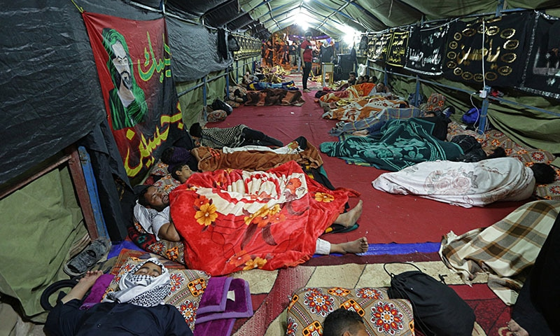 In this October 27 photo, pilgrims rest during a pilgrimage to holy shrines for Arbaeen, outside Karbala, Iraq.  — AP