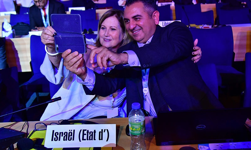 Members of Israeli delegation take a selfie during the The International Telecommunication Union Plenipotentiary Conference (ITUPP) conference in Dubai on October 29. — AFP