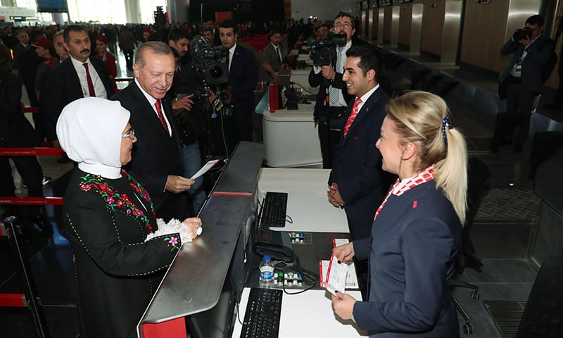 Turkish President Recep Tayyip Erdogan and his wife Emine Erdogan doing a symbolic check-in and taking their tickets on the opening day of the Istanbul Grand Airport. ─ AFP
