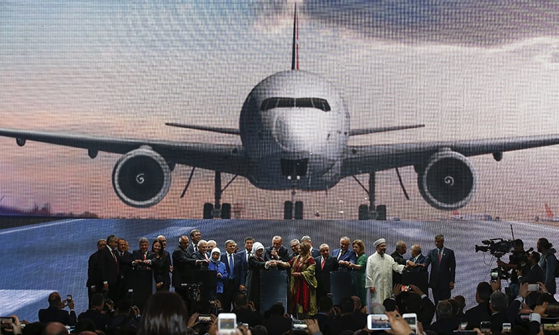 Turkish President Recep Tayyip Erdogan centre, along with other officials, inaugurates the new airport in Istanbul. ─ AP