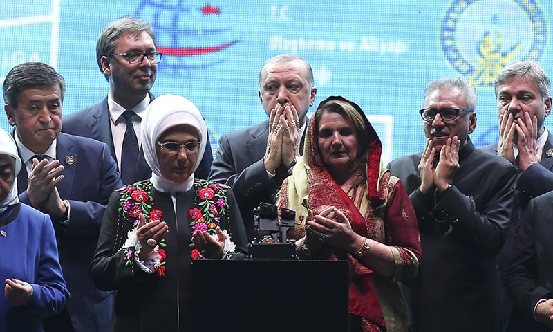 Turkish President Recep Tayyip Erdogan, center, and Turkish officials pray as he inaugurates the gleaming new aviation hub in Istanbul. ─ AP