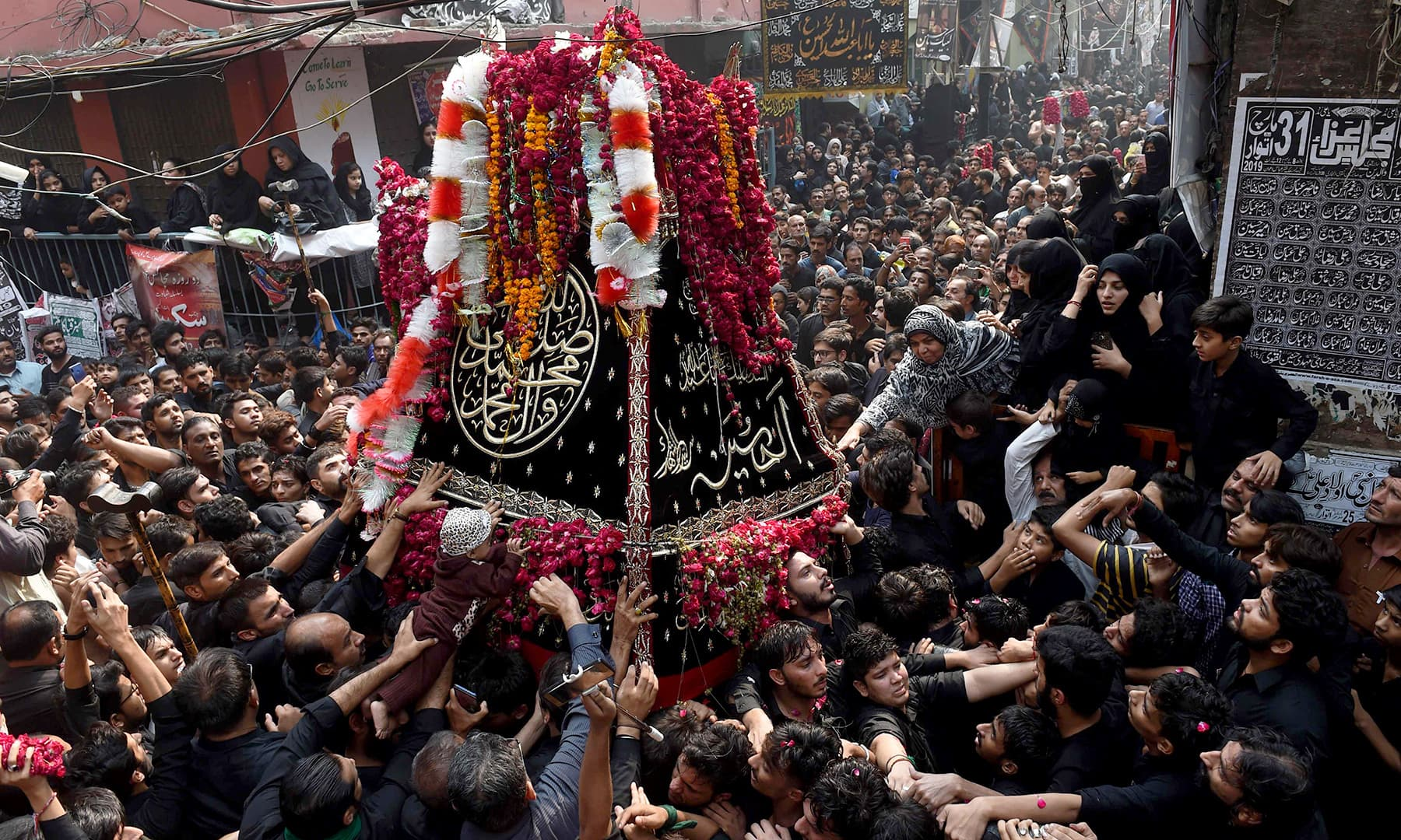 Participants of the main procession in Lahore. —AFP