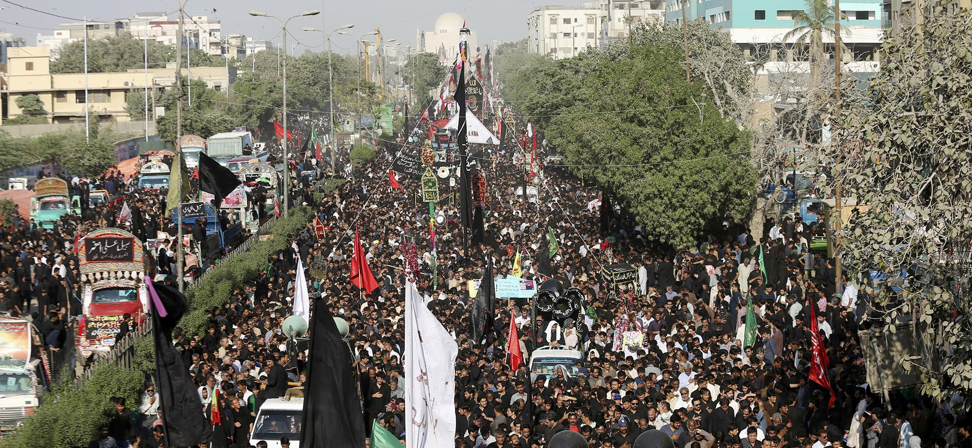 Pakistani Shiite Muslims attend a procession to mark the end of the forty day mourning period following the anniversary of the 7th century death of Imam Hussein, the Prophet Muhammad's grandson and one of Shiite Islam's most beloved saints, in Karachi, Pakistan, Tuesday, Oct. 30, 2018. (AP Photo/Shakil Adil) — Copyright 2018 The Associated Press. All rights reserved
