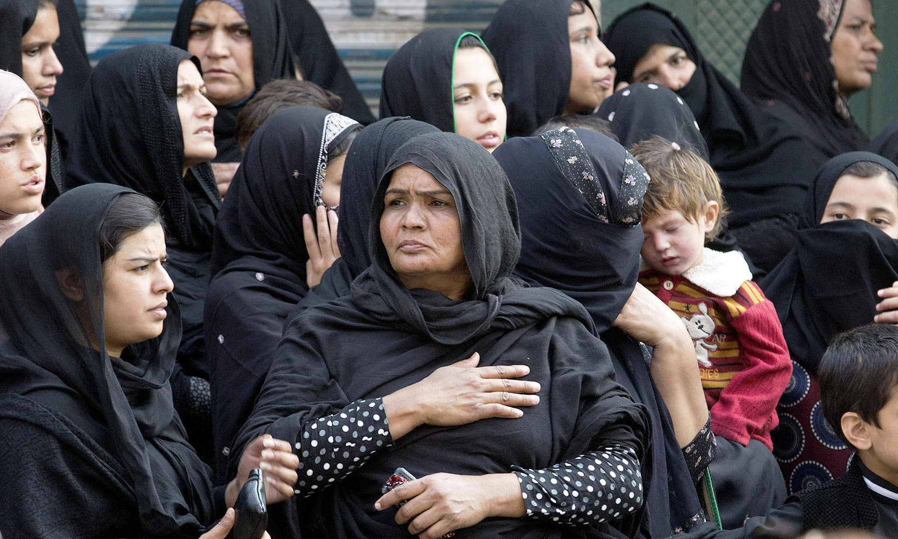 Women participating in Rawalpindi's procession. —AP