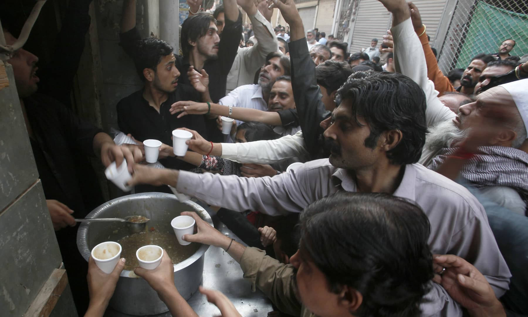 Mourners receive free food and drinks at *sabeel* stalls. —AP