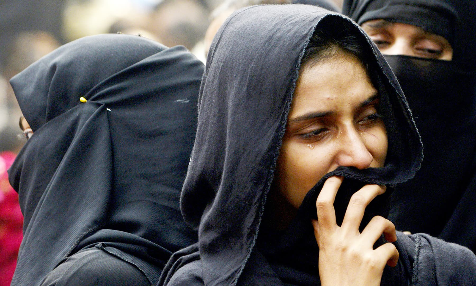 Female participants of the procession taken out in Lahore. —AFP