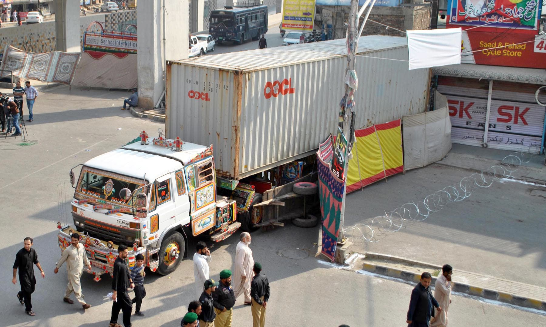 Roads leading to the route of the main procession have been closed with containers for security reasons in Rawalpindi. —APP