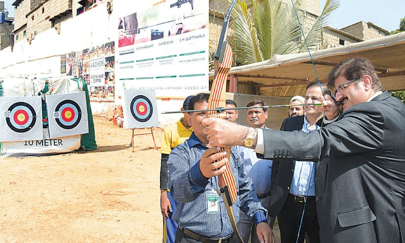 THE chief minister takes aim with a bow and arrow at the new sports complex on Wednesday.—APP