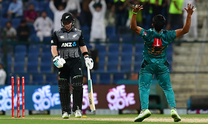 Hasan Ali (R) celebrates after he dismissed New Zealand's Tim Seifert (L). — AFP