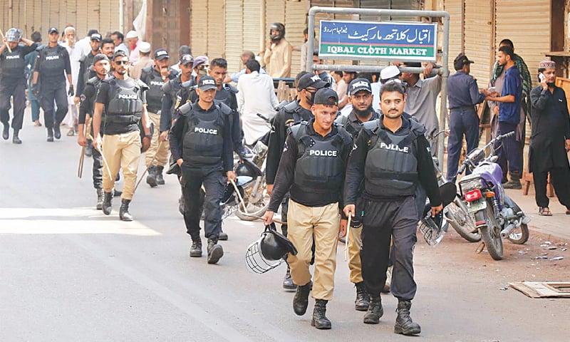 Law enforcers patrol a market.—White Star / Online