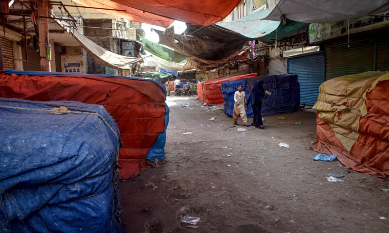 KARACHI: Shops are closed in Jodia Bazaar, the country's wholesale commodity market on Thursday.—Photo by Fahim Siddiqi