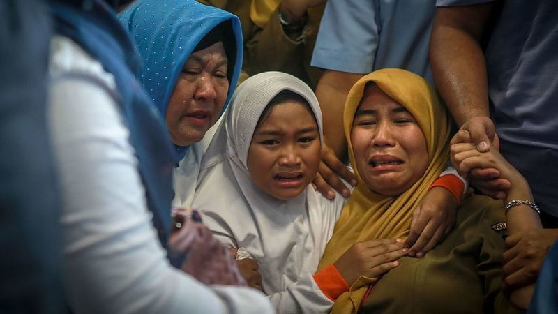 Earlier distraught family of passengers gather at Pangkal Pinang airport, where the plane had been headed. ─ AFP/File Photo