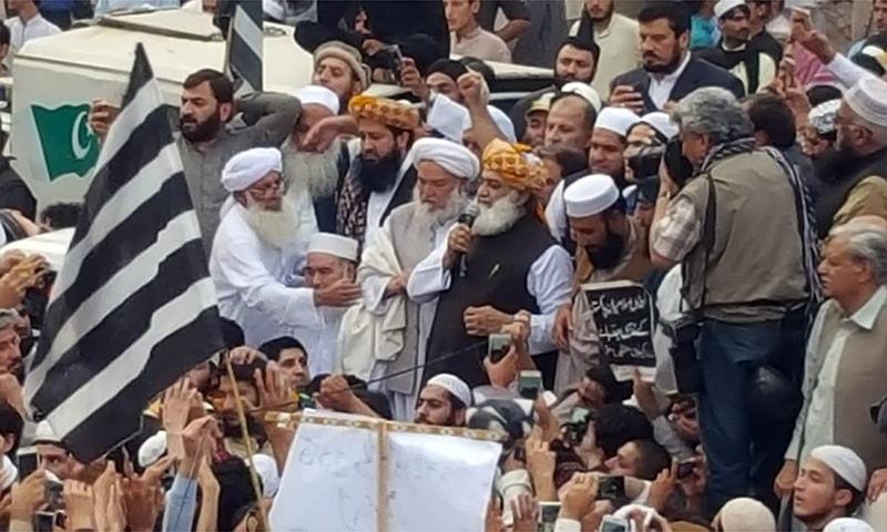 JUI-F chief Maulana Fazlur Rehman addresses a protest gathering in Peshawar. — Photo by Sirajuddin