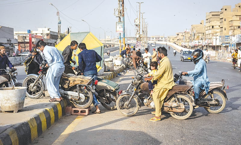 Motorcyclists face problems due to the blocked roads on Friday.—Fahim Siddiqi / White Star